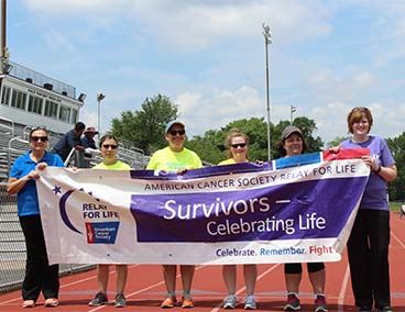 2018 Relay for Life Cancer Survivors holding a banner